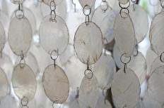 Wind chimes can be used as a visual tool to frighten woodpeckers.