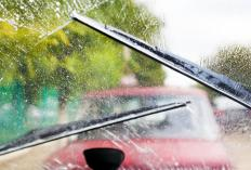 Solvent is typically sprayed on a windshield as wipers activate to clean and wipe the main viewing area.