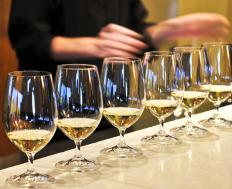 Glasses of white wine at a wine tasting party.