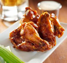 Chicken wings can be baked in the oven or prepared on the grill.