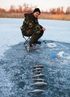 An ice fisherman can use a hole augur specifically made to cut through ice.