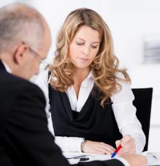 A finance director communicates financial issues to the other members of a company.