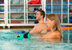 Weights help add resistance to pool workouts.