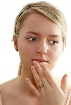 Physicians may prescribe ointment containing salicylic acid to treat lip warts.