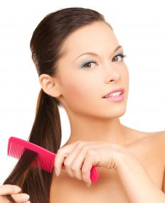 Using a wide toothed comb to work out tangles can help minimize damage to the hair.
