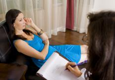 A woman working with a mental health social worker.