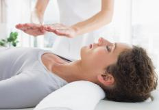 In Reiki 1, hand placement on the body, focusing on healing zones, is taught.