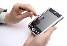 A person using a stylus with a PDA.