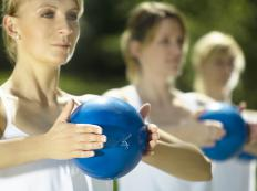 Medicine balls may be used in a wide variety of workout classes, including toning yoga and pilates.