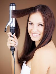 A wider curling iron will create looser curls.