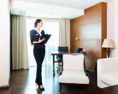Executive housekeepers inspect hotel rooms.