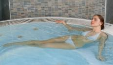 Vaginal blisters can be caused by wearing wet bikini bottoms for too long or bathing in chemically inbalanced hot tubs.