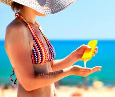 Even when under a beach umbrella, it's important to use sunblock to shield skin from the sun's damaging rays.