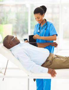 A registered nurse is responsible for monitoring patients' health and answering their questions.