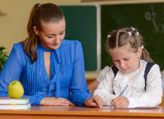 A speech pathologist may work one-on-one with a student in a school setting.