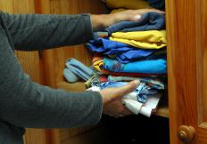 Shaker wardrobes may have no drawers, but just a top shelf and space for hanging clothing.