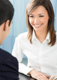 Maintaining eye contact is important when interviewing for a clerical assistant position.