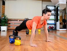 Push-ups strengthen and tone the chest, arms and shoulders.
