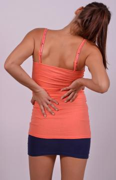 Sharp back pain may be caused by a muscle spasm.