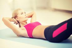 Anaerobic exercises like sit ups can help a person burn fat and lose weight.