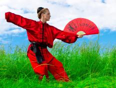 A Tai Chi Fan has evolved from a weapon to an object that is used in group Tai Chi fan performances.