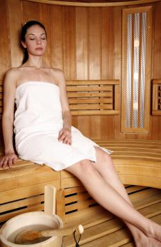 A woman in a sauna, a type of leasehold improvement.