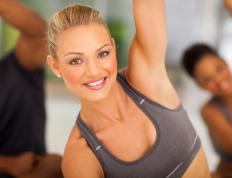 Women should wear a well-fitted sports bra for a yoga class.