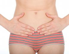 Abdominal bloating and abnormal bleeding may indicate the presence of ovarian cancer.