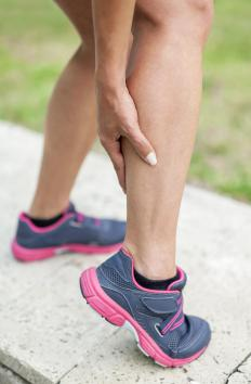 A calf stretcher isolates the calf muscle to stretch it effectively in preparation for a workout.