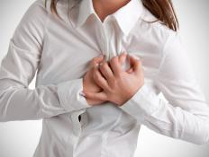 Angina symptoms include tightness in the chest.
