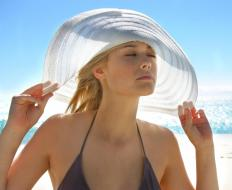 Modern petasos-style hats can be used to block out sun.