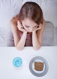 Experts often suggest taking small, slow strides towards eating a healthier diet for people suffering from anorexia.