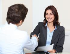 A woman giving an employer her MBA curriculum vitae.