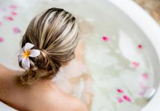 A warm bath can help relieve pain associated with a quad strain.