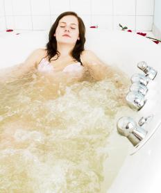 Soaking in a warm bath may help relieve thigh cramps.
