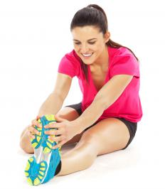 Static stretching is when a person positions her body in a stretch and then holds it for a time.