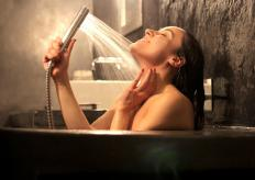 A hand shower usually comes attached to a long length of metallic hose.