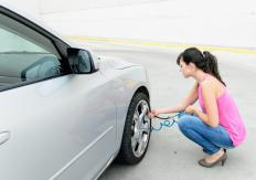 A woman filling her tires up with air.