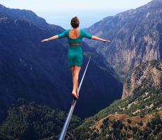 A tightrope walker, who is a type of acrobat, must be dedicated, patient, limber, and willing to practice his or her craft.