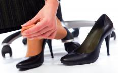 Avoiding high heels can help to prevent toe cramps.