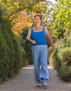 Walking is a low impact way for seniors to burn calories.
