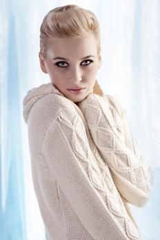 Woman wearing a cashmere sweater.