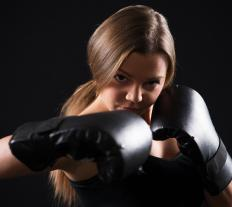 A home boxing gym should contain boxing gloves.