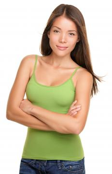 A woman wearing a tank top with spaghetti straps.