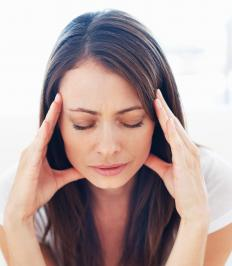 A woman with a muscle tension headache.