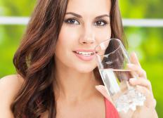 Staying hydrated with water may help prevent dry cervical mucus.