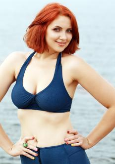 A full-figured woman with a small waist may benefit from choosing a two-piece bathing suit that contains a built-in bra.