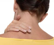 A woman experiencing muscle stiffness in the neck.