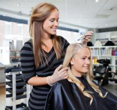 A professional hair colorist can advise a customer on the best method to lighten hair.