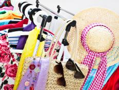 A fashion stylist coordinates accessories with clothing to assemble attractive outfits.
